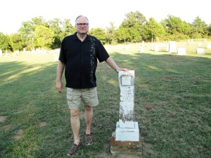 Gary stands beside grave of W.O. Smithson in Starkey Cemetery in Montague County, Texas (September 2015)