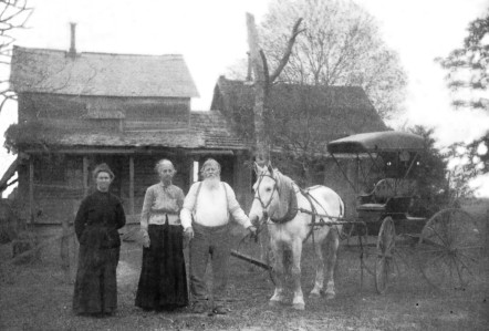 Cornelia Lassiter, Lavina Jane and John Anderson Roberts in front of their Lamar County Home in the Maxey Community ca 1890 - 1895