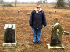 Dee Roberts visits the gravesites of John and Lavina Roberts in the Little Vine Cemetery on a cold February day in 2014 (Sumner, TX)