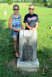 Aubrey and Camy Roberts at their 3x great-grandfather John Anderson Roberts grave in Little Vine Cemetery near Sumner, TX in Lamar County