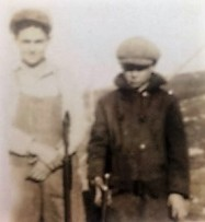 My dad, B.L. Roberts is on the right ca 1930. Both boys have pump .22 rifles.