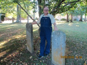 Gary between the headstones of Thomas and Elizabeth Gibson Blackwell in Franklin, TN
